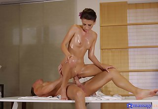 Masseuse Kate Rich gives a table handjob before she's oiled coupled with fucked