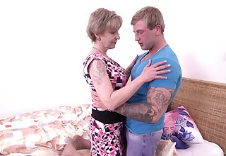 Chesty older dame Mili loves a blond boy's thick endow with