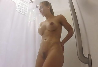 Muscular Nicole Aniston precipitation after a workout
