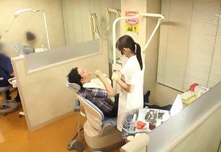 Japanese dentist Kiritani Nao flashes boobs and gets fucked hard
