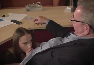 Amazing brunette with glasses is having a ffm threesome at work and enjoying drenching a lot