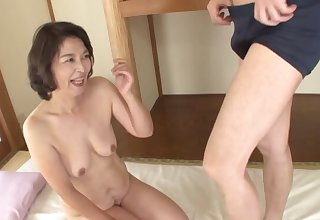 Asian mature Kitamura Toshiyo gets her puss licked and dicked