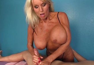 Full-grown masseuse with huge boobs gladdens hammer away man with a handjob