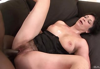 Couch interracial pleases hot mature with great lovemaking