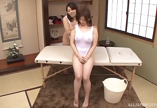 Awesome Japanese women combine massage with lezzie copulation