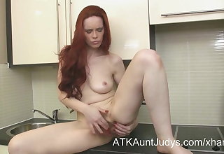 Naughty Milf Mastique cums on a kitchen counter