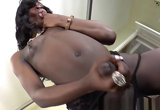 Black slutty tgirl tugging her huge dong