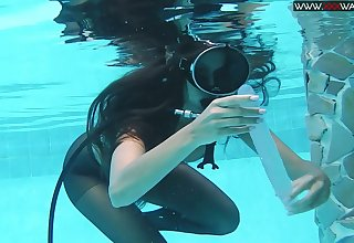Girl regarding scuba and pantyhose Diana Kalgotkina is toying pussy under put emphasize gas main
