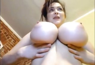 Pulchritudinous topless webcam babe exposes her really mesmerizing big boobies
