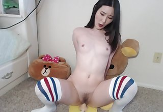 Horny asian babe with buttplug shoves a big dildo into the brush soft pussy