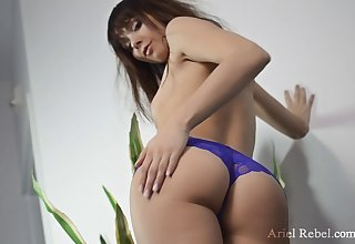 Solo tot Ariel Rebel in purple panties penetrating her vagina