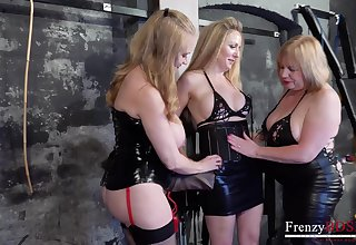 Three venerable lesbians are fucking each others cunts in the BDSM room