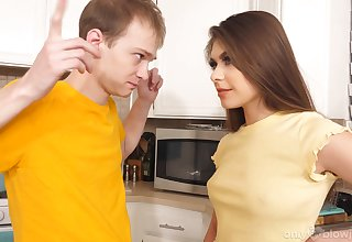 Naughty stepsister Winter Jade gives a good blowjob in the kitchen