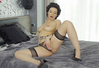 Appealing woman masturbates in say no to black lingerie with an increment of shows real orgasm